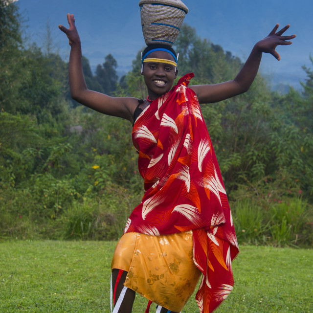 """Woman carrying a basket on her head at a ceremony of former poachers, in the..."" stock image"