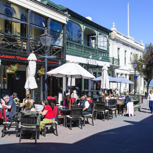 """Cafe in the pedestrian zone of Queenstwon, South Island, New Zealand"" stock image"