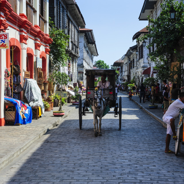 """""""Horse cart riding through the Spanish colonial architecture in Vigan, UNESCO..."""" stock image"""