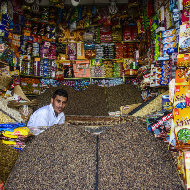 """""""Man sitting in his full shop in the Old Town, UNESCO World Heritage Site,..."""" stock image"""