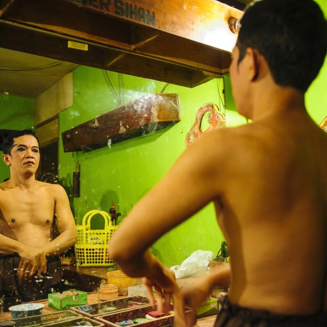 """Male dancer preparing for a traditional Javanese dance, Yogyakarta, Java,..."" stock image"
