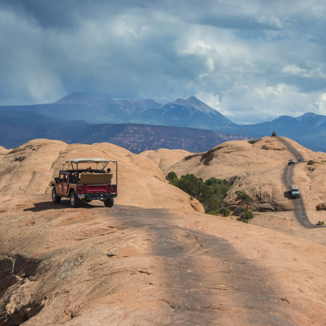 """Hummer driving on the, slickrock trail. Moab, Utah, USA"" stock image"