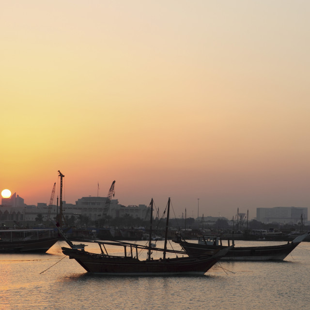 """""""Traditional wooden dhow boats in the Corniche marina, at sunset in Doha,..."""" stock image"""