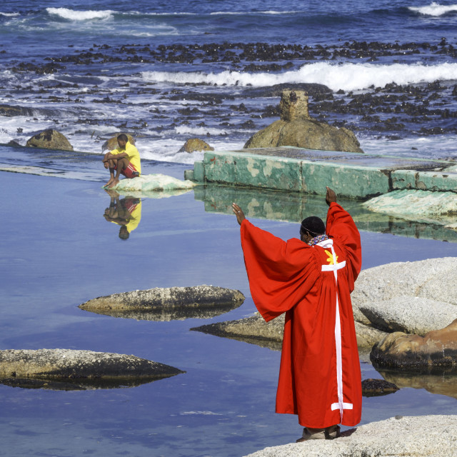 """""""Pastor raise his arms to pray before performing water baptism, Atlantic..."""" stock image"""