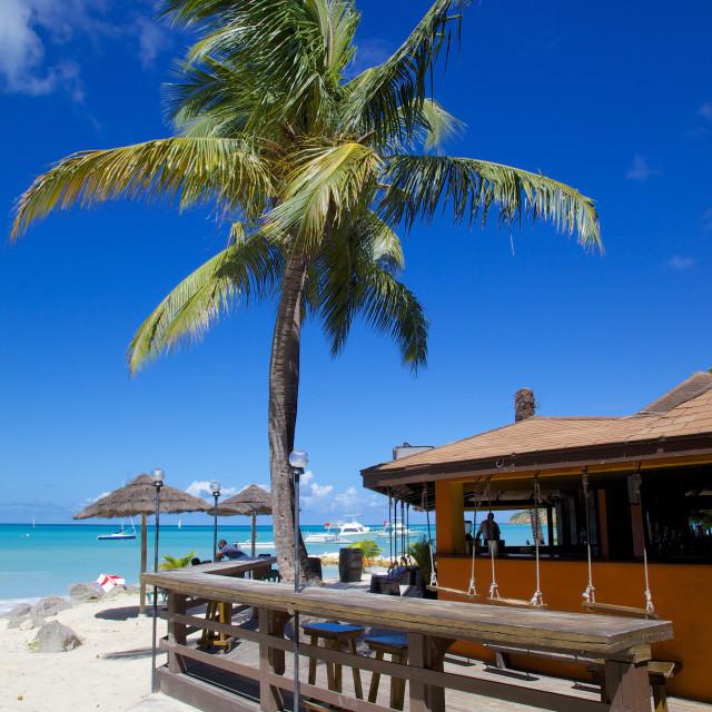 """Beach and beach bar, Dickenson Bay, St. Georges, Antigua, Leeward Islands,..."" stock image"