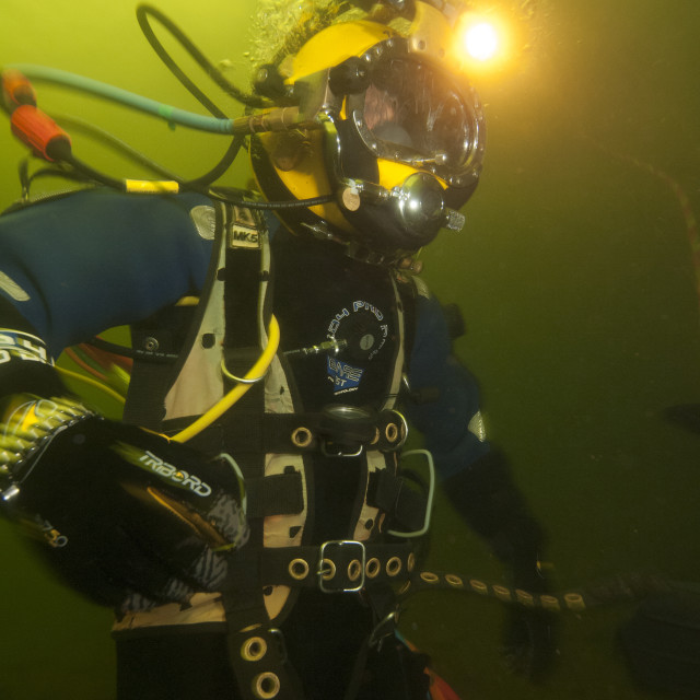 """""""Commercial diver working underwater, Fort William, Scotland, United Kingdom,..."""" stock image"""