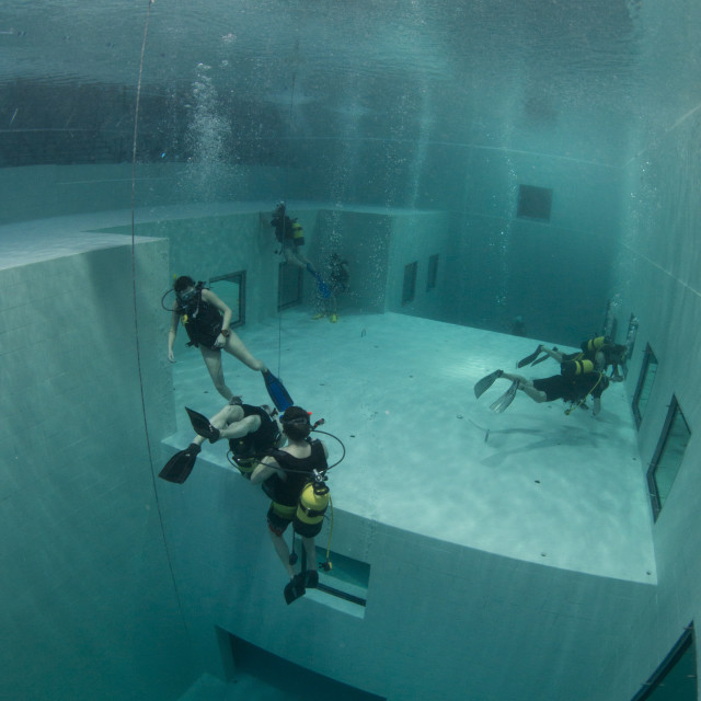 """Divers in Nemon 33 pool, the deepest swimming pool in Europe, Belguim, Europe"" stock image"