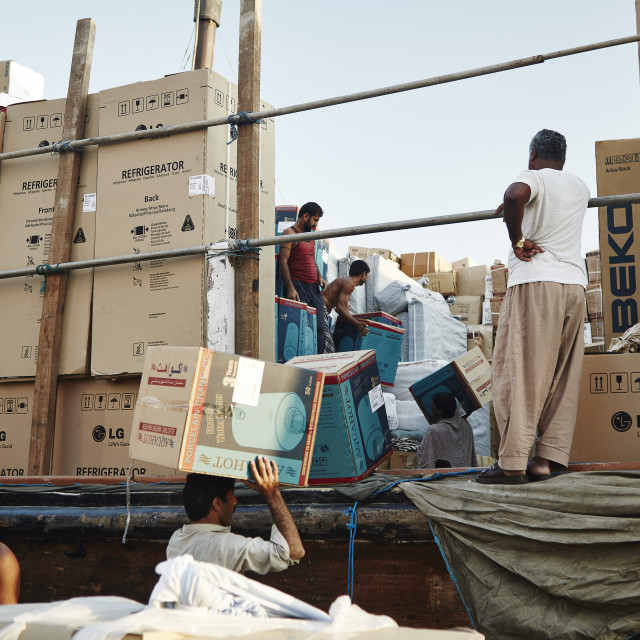 """""""Free-trade port Dubai Creek. Dhow's piled high with goods ranging from..."""" stock image"""
