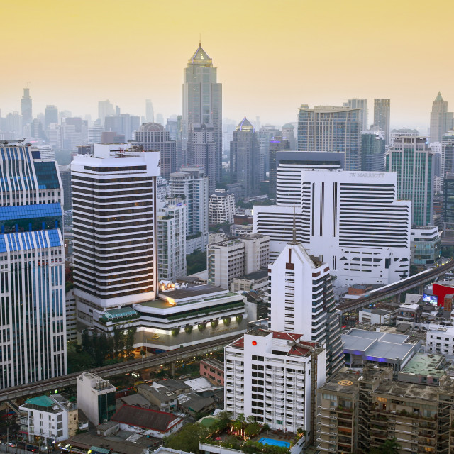 """City skyline looking along the BTS Skytrain, Sukhumvit Road and Phloen Chit,..."" stock image"