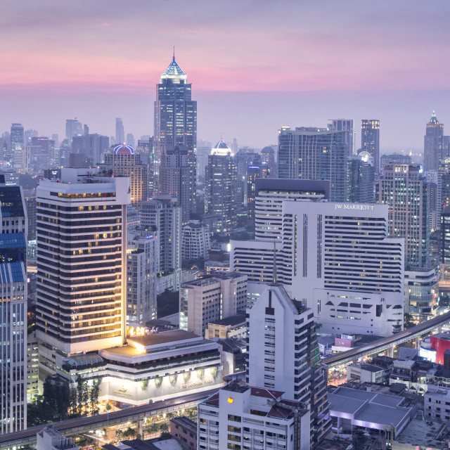 """City skyline looking along the BTS Skytrain, Sukhumvit Road and Phloen Chit..."" stock image"
