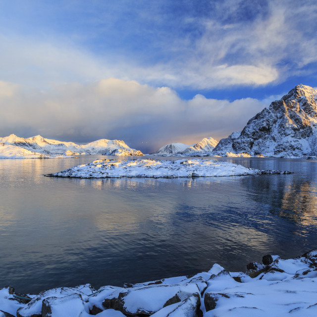 """""""The feeble light of the sunset on a fjord near Henningsvaer covered in snow,..."""" stock image"""