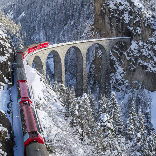 """The red train of the Albula-Bernina Express Railway, UNESCO World Heritage on..."" stock image"