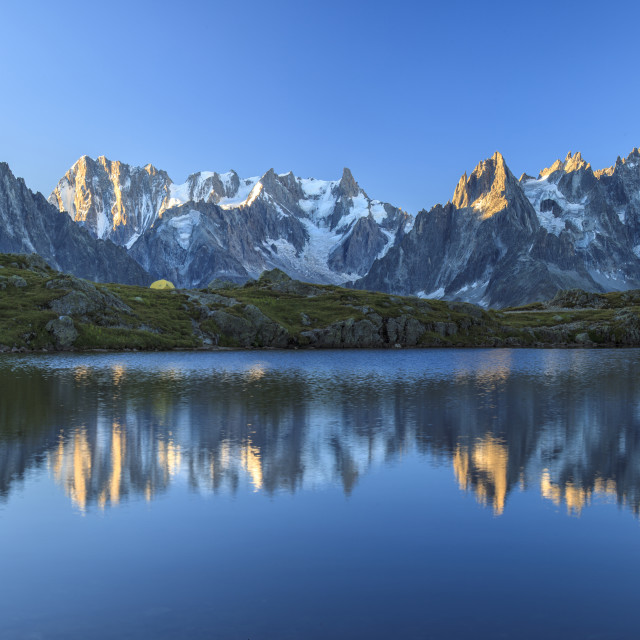 """Grandes Jorasses and Dent du Geant reflected at sunrise in Lac des Cheserys,..."" stock image"