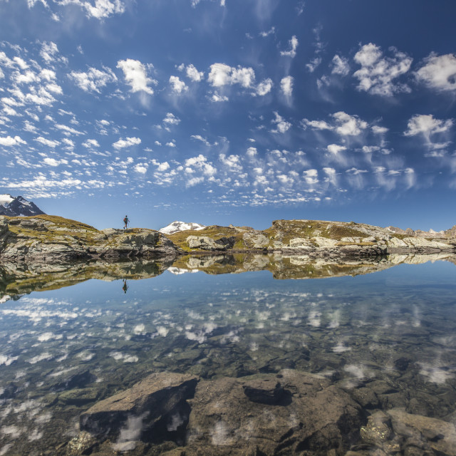 """The reflection of the Engadine sky in the the magic of the crystal-clear..."" stock image"
