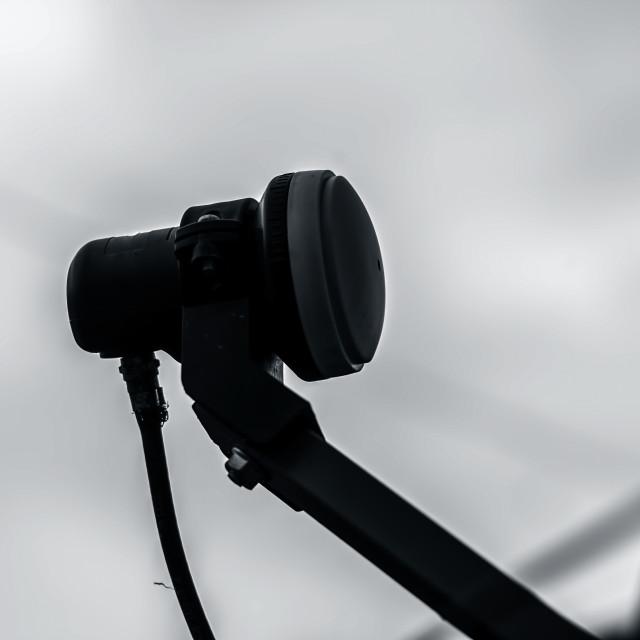 """Close up of satellite camera."" stock image"