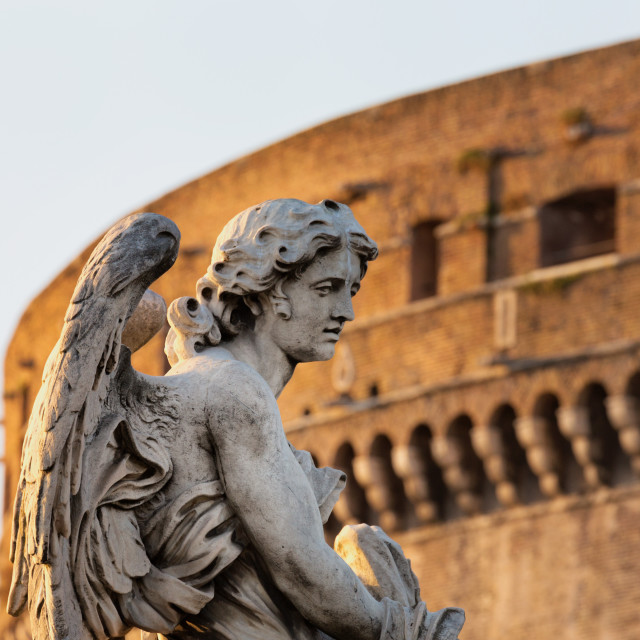 """Angel statue on Ponte Sant' Angelo with Castel Sant' Angelo, Rome, Lazio,..."" stock image"