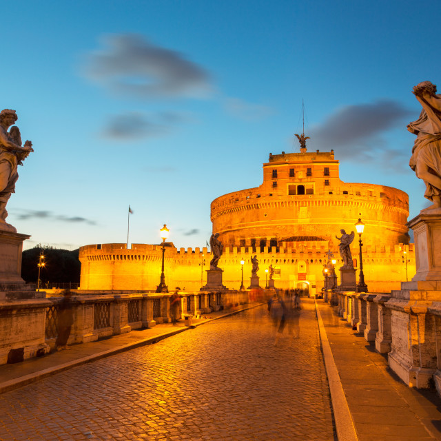 """Angel statues on Ponte Sant' Angelo bridge with Castel Sant' Angelo at dusk,..."" stock image"