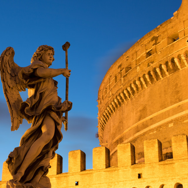 """Angel statue on Ponte Sant' Angelo bridge at dusk with Castel Sant' Angelo,..."" stock image"