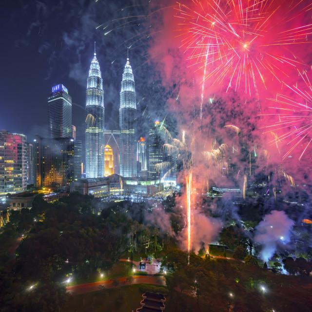 """Fireworks display show over Kuala Lumpur city skyline"" stock image"