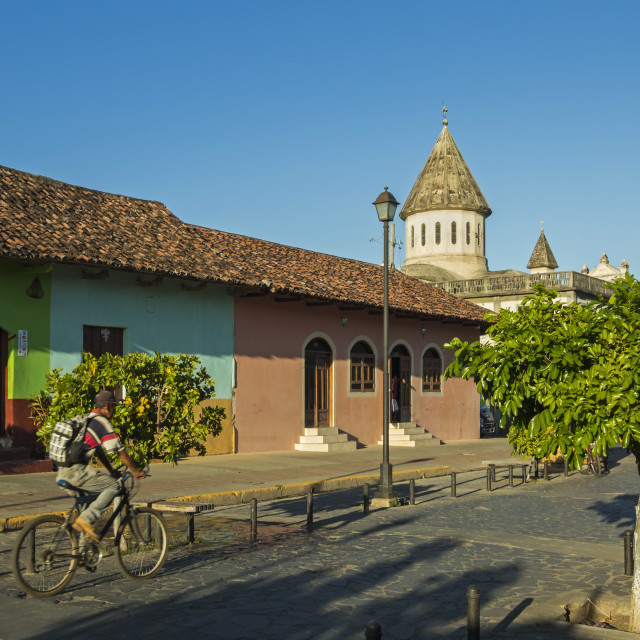 """Colourful buildings and Church of Guadelupe on popular Calle de la Calazada..."" stock image"