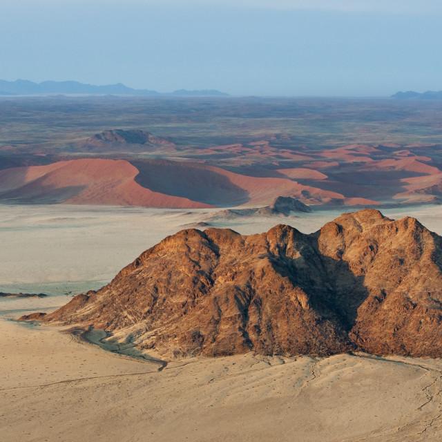 """Aerial view of dunes while ballooning over Sossusvlei at sunrise, Namib..."" stock image"