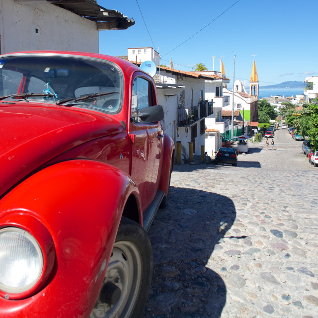 """Red Volkswagen Beetle in residential street, Downtown, Puerto Vallarta,..."" stock image"