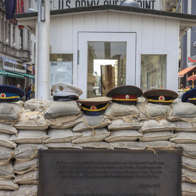 """Commemorative plaque, guardhouse, sandbags and uniform caps, Checkpoint..."" stock image"