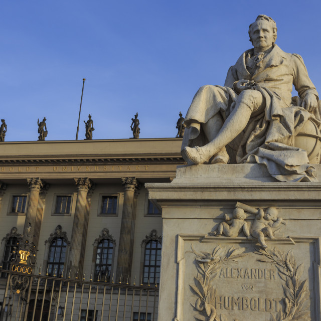 """Statue of Alexander Humboldt lit by early morning sun, Humboldt University,..."" stock image"