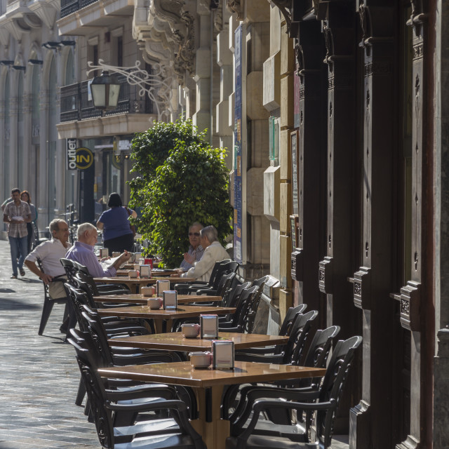 """Men sit at cafe tables in the main street, Cartagena, Murcia Region, Spain,..."" stock image"