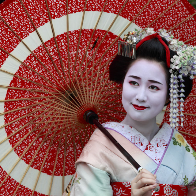 """Portrait of smiling geisha in floral robes with red umbrella in summer,..."" stock image"