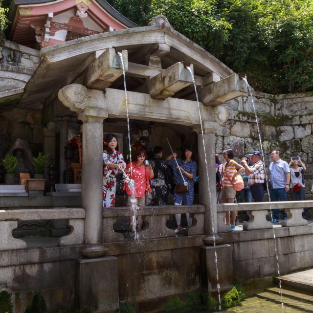 """Otowa-no-taki spring, visitors taking sacred waters, Kiyomizu-dera, Buddhist..."" stock image"