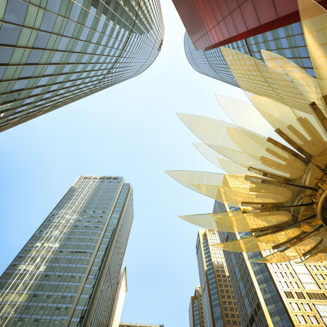 """""""Glass and golden metal Lotus installation in front of HSBC Bank with..."""" stock image"""