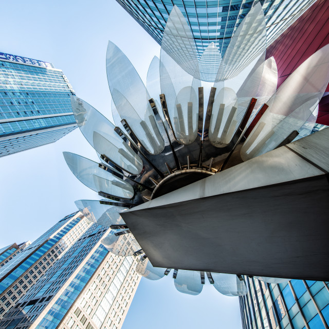 """""""Glass and metal Lotus installation in front of HSBC Bank with surrounding new..."""" stock image"""