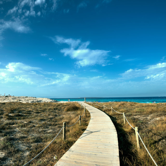"""Boardwalk leading towards the horizon and Infinity Beach on Formentera."" stock image"