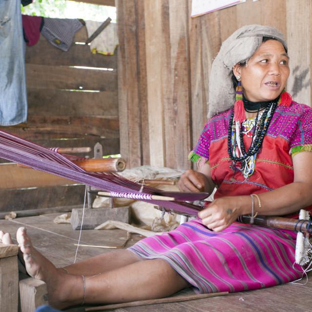 """A Karen villager weaving traditional textiles, Chiang Mai, Thailand,..."" stock image"