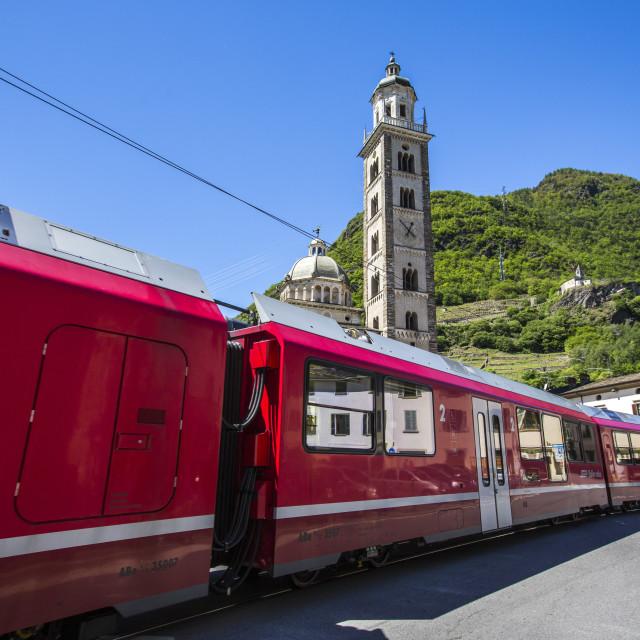 """The Bernina Express train passes near the Sanctuary of Madonna di Tirano, not..."" stock image"