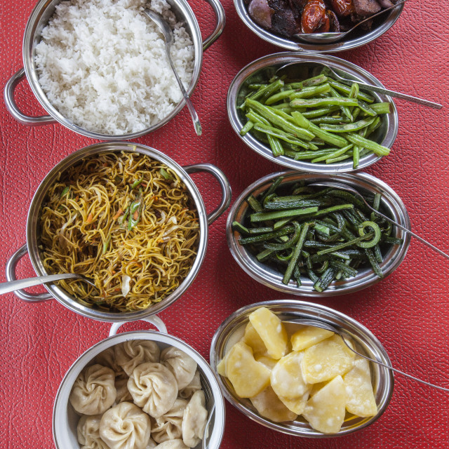 """Bhutanese dishes served at a restaurant in Thimphu rice and vegetables..."" stock image"