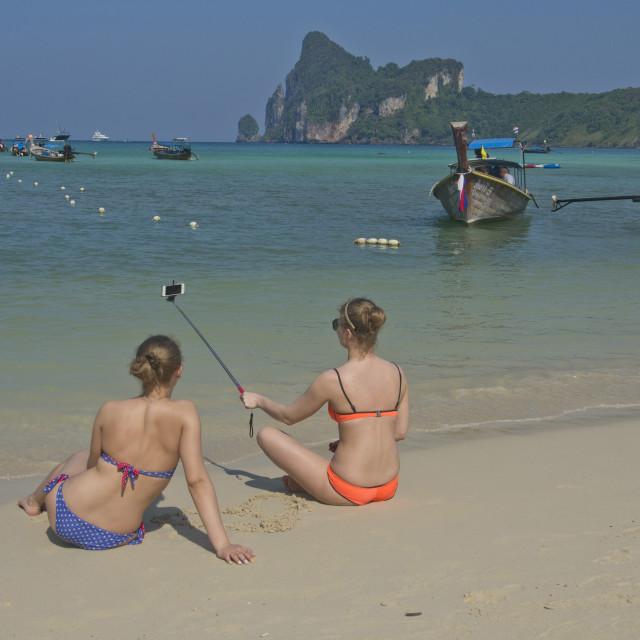 """Western women tourists take selfie photo on beach at Phi Phi islands, Andaman..."" stock image"