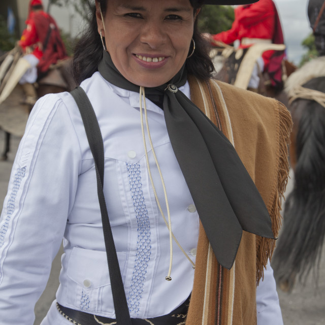 """""""Woman ina parade of gauchos in traditional costumes in Salta, Argentina"""" stock image"""