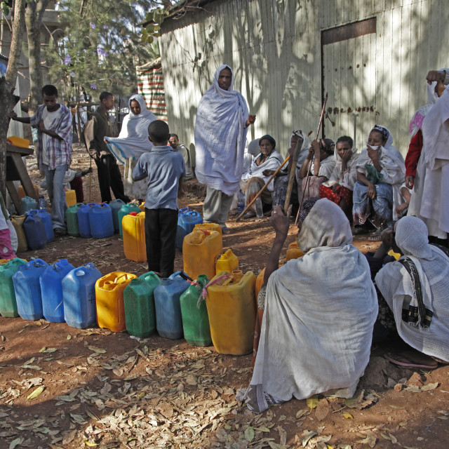"""Women queue for water with plastic cans in the outskirts of Addis Ababa,..."" stock image"