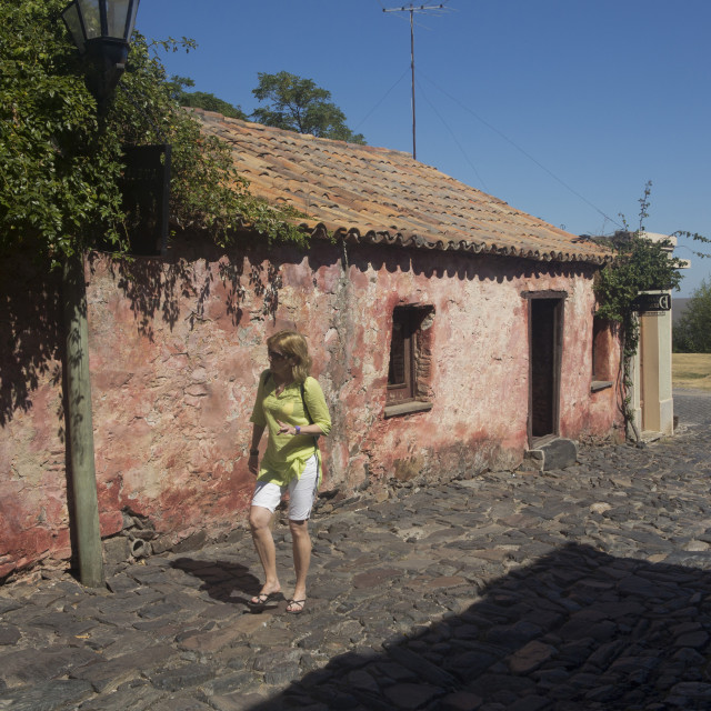 """""""Tourists in the old colonial town of Colonia in Uruguay"""" stock image"""