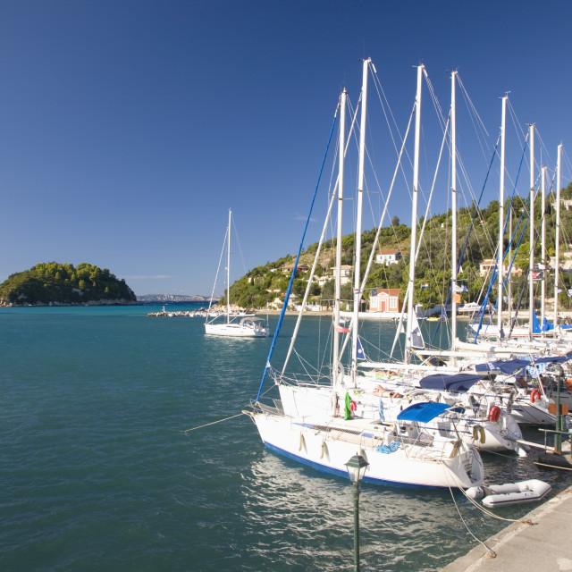 """View across Lakka Bay, yachts lined up along the quay, Lakka, Paxos, Paxi,..."" stock image"