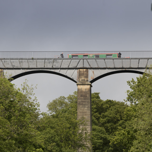 """A narrow boat crossing the Pontcysyllte Aqueduct on the Llangollen Canal over..."" stock image"