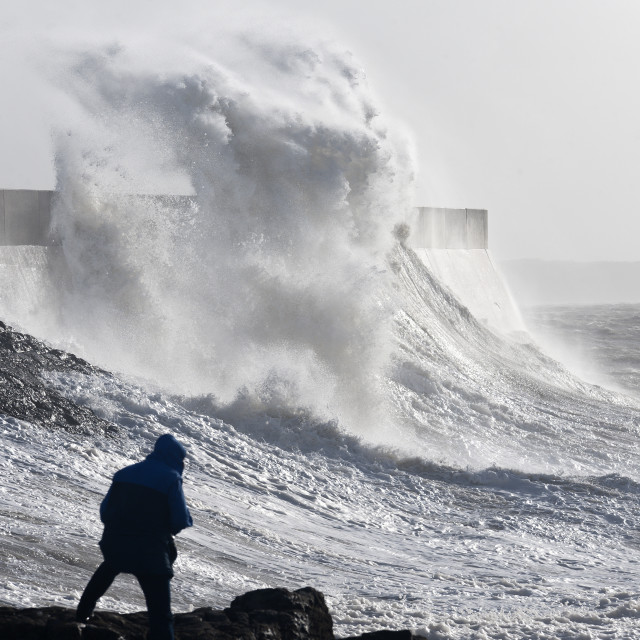 """""""Waves crash against the harbour wall at Porthcawl, Bridgend, Wales, United..."""" stock image"""