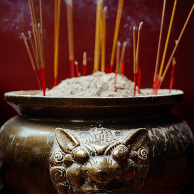 """Incense Sticks Burning in Asian Temple"" stock image"
