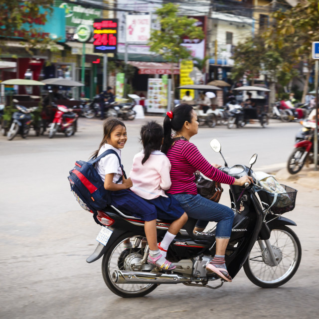 """""""Mother and daughters riding a scooter, Siem Reap, Cambodia, Indochina,..."""" stock image"""