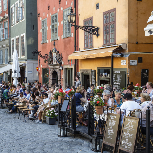 """People sitting at a restaurant in Stortorget square in Gamla Stan, Stockholm,..."" stock image"