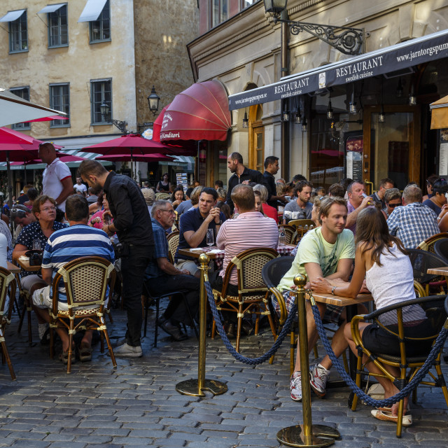 """People sitting at a restaurant in Jarntorget square in Gamla Stan, Stockholm,..."" stock image"