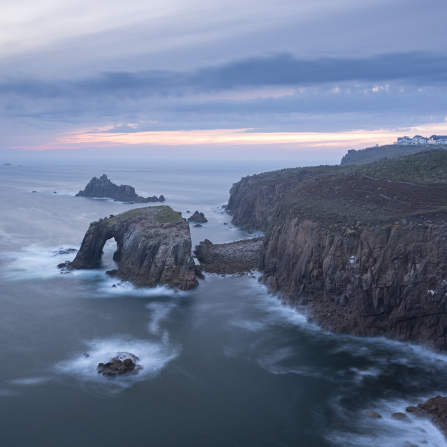 """Sunset over the dramatic cliffs of Land's End, Cornwall, England, United..."" stock image"