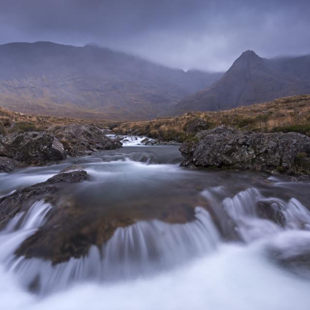 """The Fairy Pools beneath the Cuillin Hills mountain range, Isle of Skye, Inner..."" stock image"